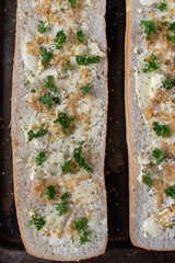 prepared cut whole french bread with butter, garlic, and parsley