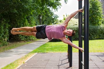 Young athlete having calisthenics flag workout.