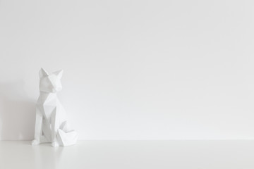 Origami home decor and white wall mock up.