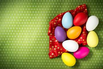 Easter eggs on a beautiful green background in white peas. Festive background. Easter ideas. Space for text. Happy easter.