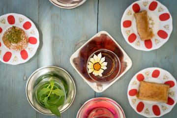 traditional Turkish red black tea tulip glass green flowers sweet dessert afternoon tea break