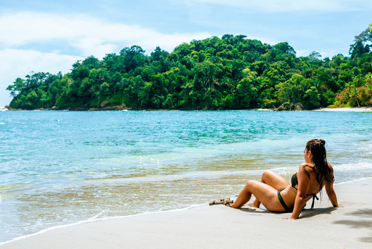Woman lying on the beach of Manuel Antonio National Park, Costa Rica.
