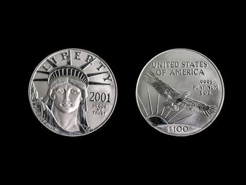 1oz Platinum 100 dollar coin on a black background.