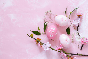 decorated eggs for Easter on a pink background