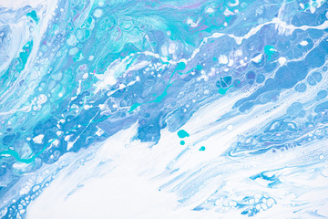 Beautiful background of liquid acrylic in blue, green and white on canvas