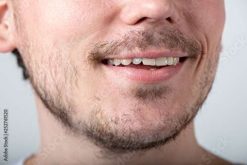 Handsome man with stubble or beard on face close up