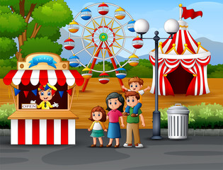 Happy family in the Amusement park