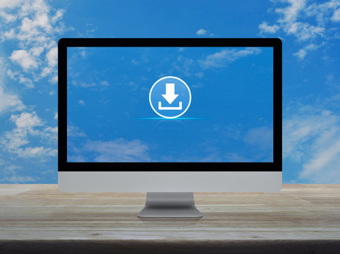 Download flat icon on desktop modern computer monitor screen on wooden table over blue sky with white clouds, Technology internet online concept