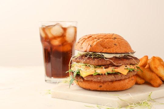 Tasty burger on light table