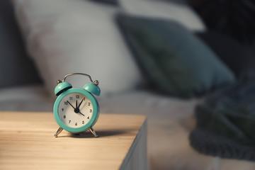 Alarm clock on table in bedroom Wall mural