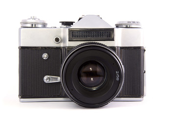 old film mirror full-frame photo camera with lens on white background. isolated.