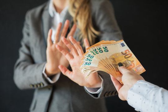 Woman refusing to accept bribe money