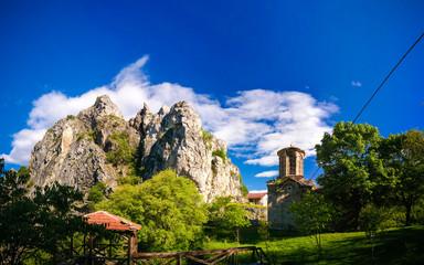 Fototapeta Exterior view to St. Nicola Shishevski monastery at the mountains above Matka Canyon, North Macedonia obraz