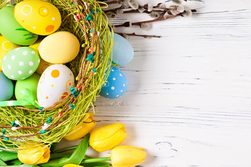 Happy Easter. Congratulatory easter background. Easter eggs and flowers. Background with copy...