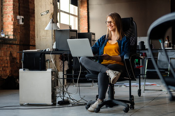 A girl works at a computer in a modern office
