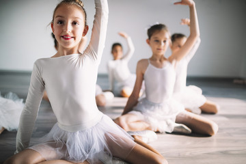 Canvas Prints Dance School Group of fit happy children exercising ballet in studio together
