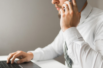 Shopping online. sending email, mobile phone. Close up telephone. Office work concept. Businessman uses a smartphone. White background.