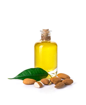 Bottle of almond oil on white background