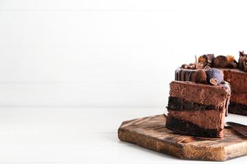 Tasty chocolate cake on white table