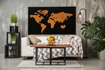 Interior of modern room with picture of world map on wall