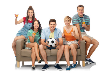 entertainment, leisure and people concept - group of happy smiling friends or football fans with soccer ball sitting on sofa with non alcoholic drinks over white background