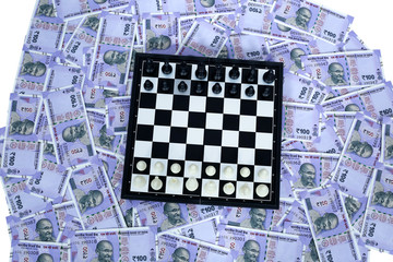 Picture of chess on the new 100 rupees currency.