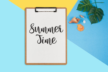 Summer Time text on white sheet on pastel color background