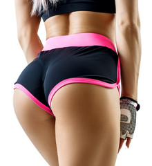 Athletic woman demonstrated her perfect muscular buttocks.