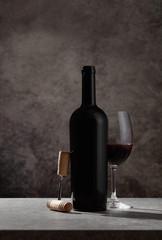 Red wine bottle,wine glass and cork screw
