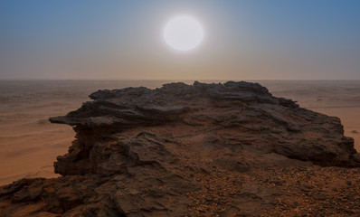 View on the evening sun over the top of the holy mountain Jebel Barkal in Karima, Sudan, africa