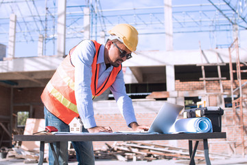 engineer planing and working on table in construction working site