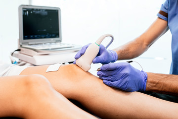 Physiotherapist giving knee therapy to a woman