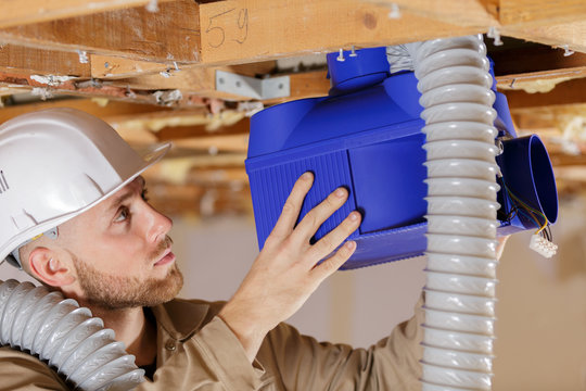 young builder with ventilation system
