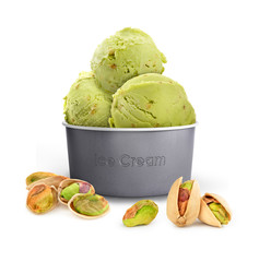pistachio ice cream in a paper cup with pistachios