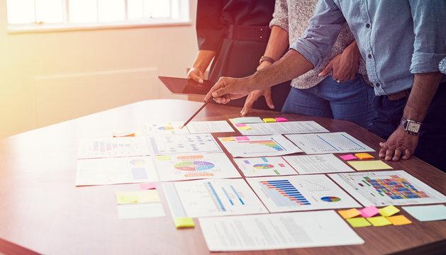Business team analyzing graphs