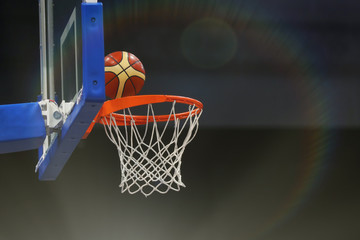 Basketball ball flies into the basketball hoop. Toned