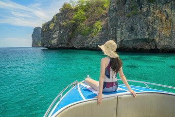 Cute girl is relaxing in the summer at the sea. Traveling by the sea.Beautiful sea of Thailand.