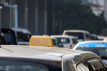 Taxi light sign or cab sign in yellow color on the car roof.