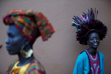 Models wait behind the scenes before a fashion show featuring African fashion and culture during a gala at the African Heritage House in Nairobi