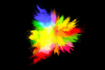 Multicolor powder explosion on black background. Colored cloud. Colorful dust explode. Paint Holi.