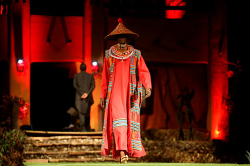 A model walks on a catwalk during a fashion show featuring African fashion and culture at the African Heritage House in Nairobi