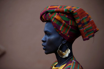 Kenyan model Ajuma Nasanyana waits behind the scenes before a fashion show featuring African fashion and culture at the African Heritage House in Nairobi