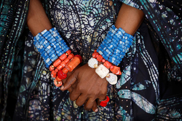 Bracelets are seen on the hands of Nigerian artist and designer Chief Nike Okundaye during a gala at the African Heritage House in Nairobi