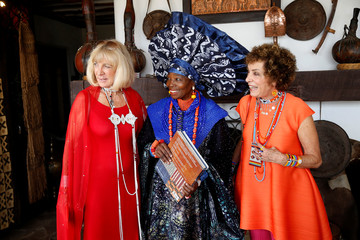 Carol Beckwith and Angela Fisher speak with the Nigerian artist and designer Chief Nike Okundaye during a gala marking the launch of their book at the African Heritage House in Nairobi