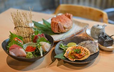 Mixed sliced fish sashimi on ice in bowl