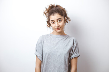 Portrait of a beautiful Indian girl. Young brunette woman on a white background.