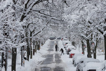 Residents shovel out following a winter snow storm in Somerville