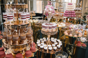 Delicious wedding reception candy bar dessert table. macaroon on candy bar, candy bar on holiday, candy bar at the wedding