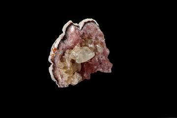Macro mineral stone Pink Amethyst on a black background