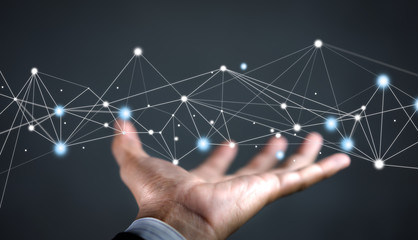 Hand of businessman on background holding connections system and global data exchanges. Business network connection concept. Wall mural